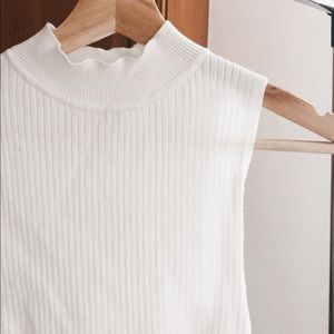 Slightly off white, ripped top